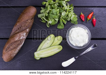 Ingredients For Sandwich With Cucumber, Cheese Cream, Pepper And Lettuce On A Wooden Background