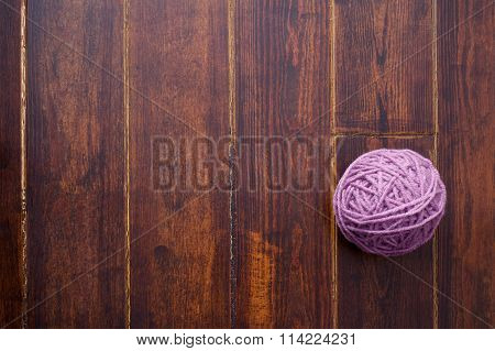 Lilac Skein Over Wooden Background