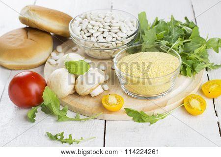 Ingredients For Vegetarian Burger: Mushrooms, Haricot, Couscous, Arugula, Tomatoes