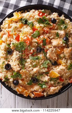 Couscous With Chicken, Olives And Vegetables Closeup. Vertical Top View