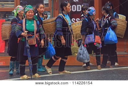 women in traditional clothes are walking, Sa Pa, Vietnam