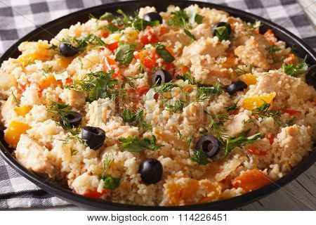 Couscous With Chicken, Olives And Vegetables Close-up. Horizontal