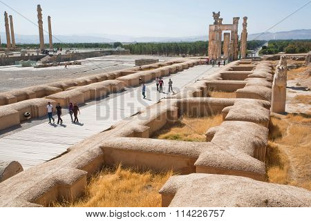 Group Of People Come In Area Of Destroyed City Persepolis, Iran.