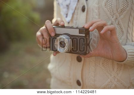 Hipster Girl Holding A Film Camera Outdoor