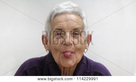 Sticking Out Tongue, Senior Woman