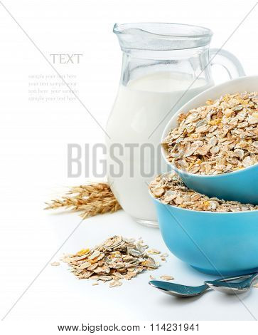 muesli in blue masks and milk jug isolated on white