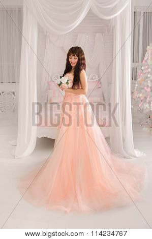 Weddings Christmas And New Year.beautiful Young Bride In A Peach Dress. The Gentle Light Bedroom.