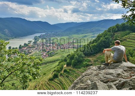 Young hiker on a rock in Wachau