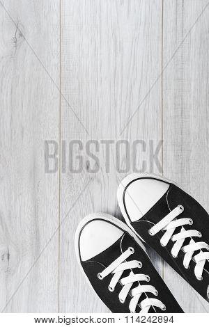 Gumshoes On Wooden Floor