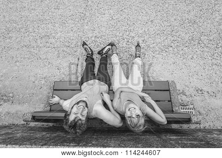 Young People Friends Relaxing On Bench.