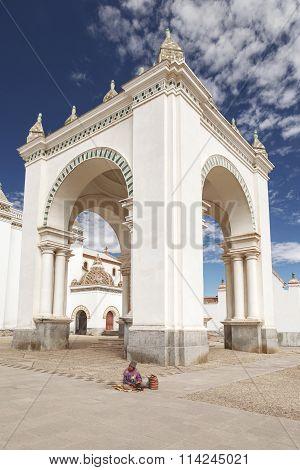 COPACABANA BOLIVIA - JULY 28 2012: Homeless old man sitting in front of Church of Nuestra senora de Copacabana lake Titicaca Bolivia