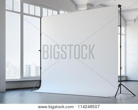 Blank white studio background in loft interior. 3d rendering