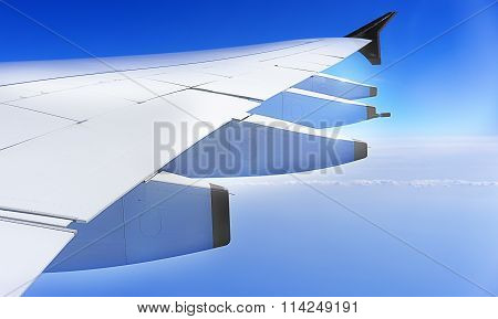 Aeroplane Wing and blue sky
