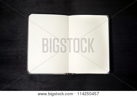Open Notebook Isolated On Black Background