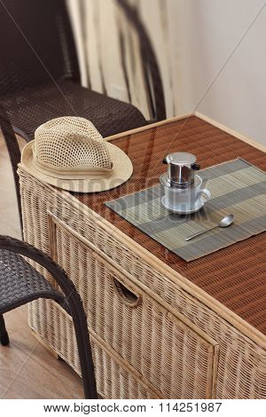 Morning Coffee Served In Vietnam Coffee Filter On Rattan Table With Two Rattan Chairs