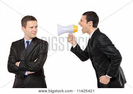 Angry Businessman Yelling Via Megaphone To Another Man