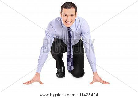 Full Length Portrait Of A Businessman Ready To Run