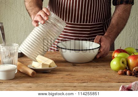 Male Chef Prepares A Pie With Apples