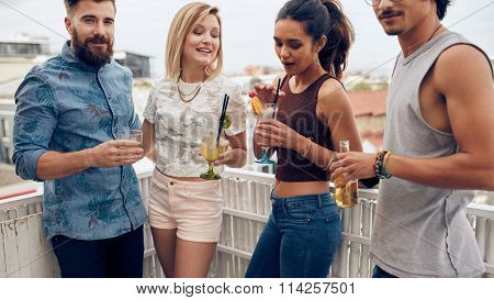 Group Of Young People Having A Party On Rooftop