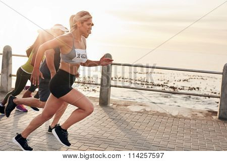 Young People Running On Seaside Promenade