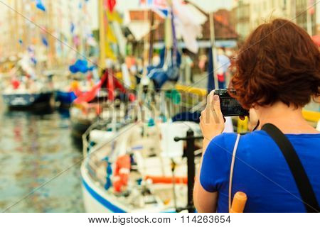 Tourism. Woman With Camera On Harbour, Bergen In Norway.