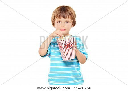 Portrait Of A Young Boy Eating Popcorn