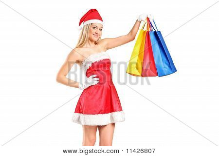 Portrait Of A Woman Dressed As Santa With Shopping Bags