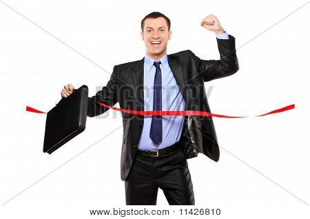 Businessman Running At The Finish Line
