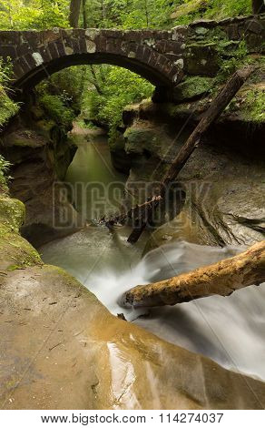 Beautiful Smooth Flowing Stream Under A Stone Bridge At Hocking Hills State Park, Ohio.