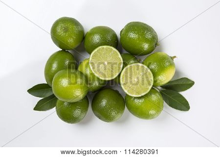 Fresh Citrus Lime With Mint Close Up On White Background.