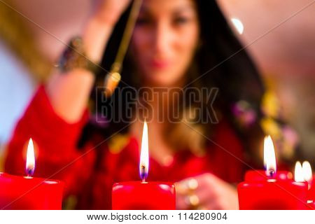 Fortuneteller radiesthesist in Seance dowsing with pendulum telling the future