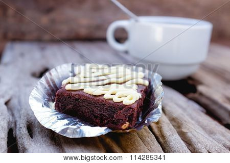 Cake Chocolate Brownie And Hot Coffee On Old Wooden Background.