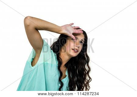 Worried woman covering her face with hand on white screen