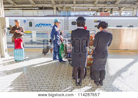 Cleaning staff on the train waiting for Shinkansen bullet train at Tokyo