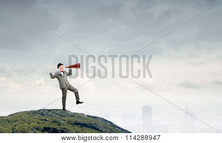 Businessman in hat with trumpet