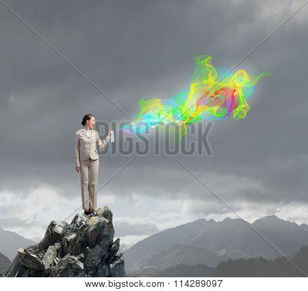 Woman spraying colors