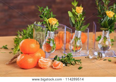 Still life with tangerines on a wooden background