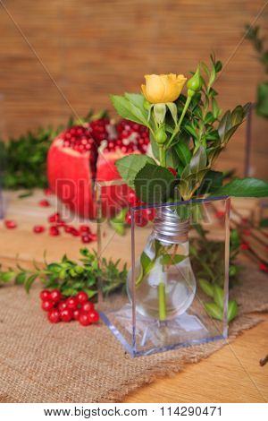 Beautiful composition with pomegranate, flowers and bulbs.