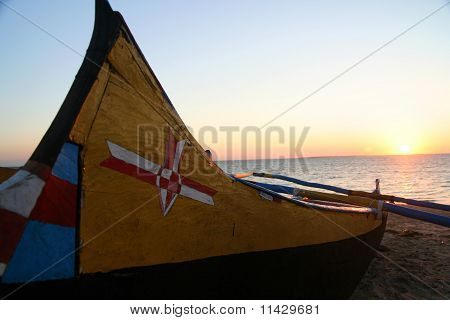 Pirogue at sunset