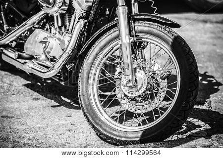 Motorcycle Front wheel close up. Black and white colors