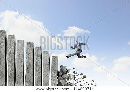 Businessman climbing stone ladder