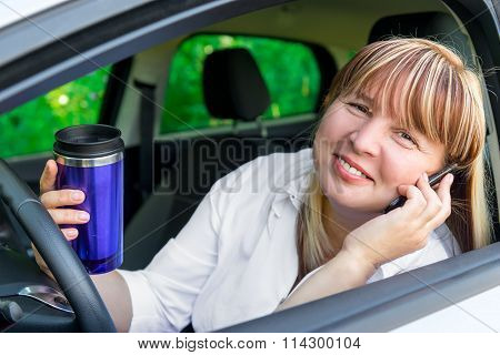 Happy Relaxed Driver Behind The Wheel Of A Car
