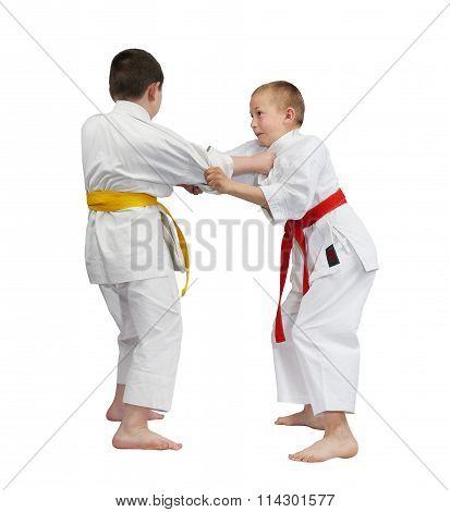 Two athletes train judo throws
