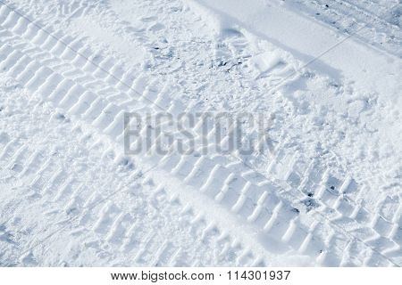 Background Texture Of  Tire Tracks On Winter Road