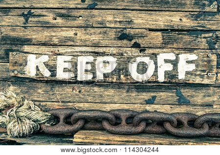 Keep Off Sign - Wooden Painted Background - Vintage Filtered Look