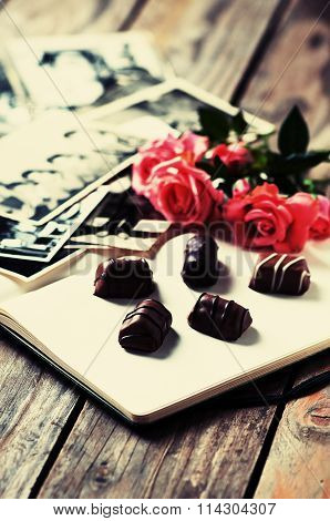 Photoalbum With Pink Rose And Chocolate
