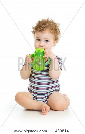 Baby drinking water from cup