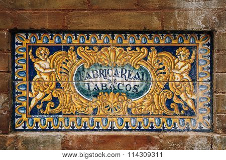Ceramic tiled sign of Royal Tobacco Factory in Seville, Spain