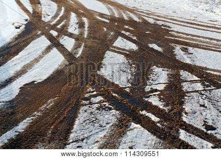 Dirty Tire Tracks On Snow.