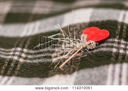 Heart On Stick With Copy-space Against Blanket Background